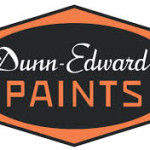 Dunn-Edwards Paints logo black oval on orange with white and orange text