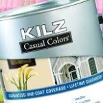 A can of Kilz paint in front of a colorful pallete